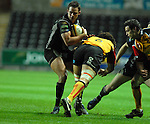Lee Byrne side steps Dragons Captain Colin Charvis. Swansea Neath Ospreys Vs Newport Gwent Dragons, Magners league, Liberty Stadium © IJC Photography. Photographer Ian Cook