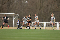 LOUISVILLE, KY - MARCH 13: Gabrielle Robinson #8 of West Virginia University and Cece Kizer #5 of Racing Louisville FC fight for the ball during a game between West Virginia University and Racing Louisville FC at Thurman Hutchins Park on March 13, 2021 in Louisville, Kentucky.