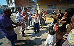 Participants dance in the street during a wedding in Suto Orizari, Macedonia. The mostly Roma community, located just outside Skopje, is considered Europe's largest Roma settlement. .