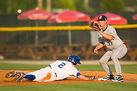 Marcus Nidiffer #22 of the Greeneville Astros waist for the ball as Alex McClure #2 of the Burlington Royals dives head first back to the base at Burlington Athletic Stadium June22, 2010, in Burlington, North Carolina.  Photo by Brian Westerholt / Four Seam Images