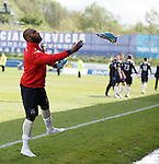 Yoann Arquin celebrates after the final whistle by throwing his boots into the Ross County support