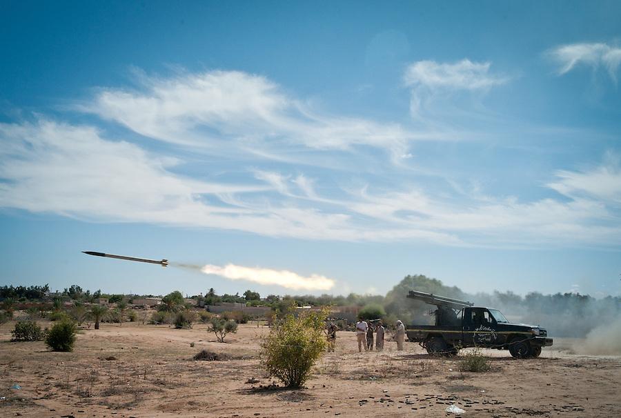 Anti-Gaddafi fighters launch Grad rockets towards Gaddafi loyalist positions in Sirte, Libya.