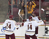 Bill Arnold (BC - 24), Adam Gilmour (BC - 14), Michael Matheson (BC - 5) - The Boston College Eagles defeated the visiting University of Wisconsin Badgers 9-2 on Friday, October 18, 2013, at Kelley Rink in Conte Forum in Chestnut Hill, Massachusetts.
