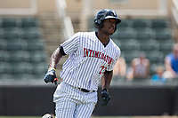 Micker Adolfo (27) of the Kannapolis Intimidators rounds first base during the game against the West Virginia Power at Kannapolis Intimidators Stadium on June 18, 2017 in Kannapolis, North Carolina.  The Intimidators defeated the Power 5-3 to win the South Atlantic League Northern Division first half title.  It is the first trip to the playoffs for the Intimidators since 2009.  (Brian Westerholt/Four Seam Images)