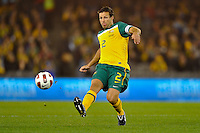 MELBOURNE, AUSTRALIA - JUNE 7: Lucas Neill of the Socceroos kicks the ball during an international friendly match between the Qantas Australian Socceroos and Serbia at Etihad Stadium on June 7, 2011 in Melbourne, Australia. Photo by Sydney Low / AsteriskImages.com