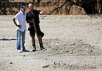 Pictured: Eddie Needham (L), the grandfather of missing Ben Needham, is shown around the soil examination process by an officer in Kos, Greece. Wednesday 05 October 2016<br />Re: Police teams led by South Yorkshire Police, searching for missing toddler Ben Needham on the Greek island of Kos have moved to a new area in the field they are searching.<br />Ben, from Sheffield, was 21 months old when he disappeared on 24 July 1991 during a family holiday.<br />Digging has begun at a new site after a fresh line of inquiry suggested he could have been crushed by a digger.