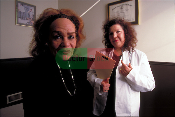 portrait of worried female patient with doctor in office
