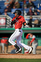 Batavia Muckdogs shortstop Dalvy Rosario (17) hits a single during a NY-Penn League game against the Auburn Doubledays on June 14, 2019 at Dwyer Stadium in Batavia, New York.  Batavia defeated 2-0.  (Mike Janes/Four Seam Images)