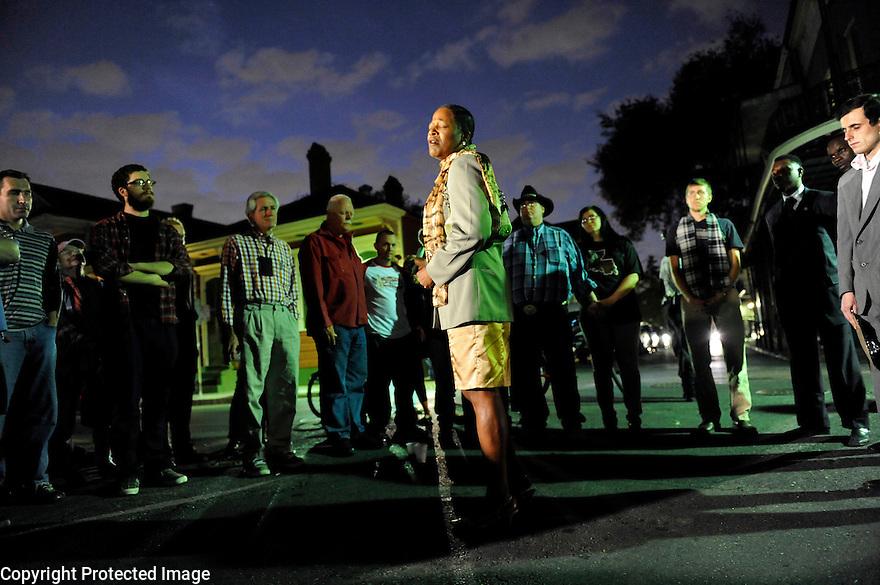 A woman sings at a vigil for murder victim Wendy Byrne, a popular bartender, French Quarter, 2009
