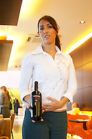 The woman sommelier presenting a bottle of Chakana Cabernet Sauvignon. The Restaurant Red at the Hotel Madero Sofitel in Puerto Madero, Buenos Aires Argentina, South America
