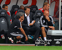 Saturday, 01 September 2012<br /> Pictured: Swansea manager Michael Laudrup (C) and goalkeeping coach Adrian Tucker (R).<br /> Re: Barclays Premier League, Swansea City FC v Sunderland at the Liberty Stadium, south Wales.