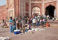 Fatehpur Sikri, Uttar Pradesh, India.  Tourists and Vendors at the Buland Darwaza (Great Gate) of the Jama Masjid (Dargah Mosque), finished 1576.