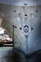 Bow of the USS Hornet moored in Alameda, California.  With imagination, a face appears:  Eyes.  A nose and mouth.