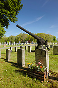 Old artillery in a New England graveyard.