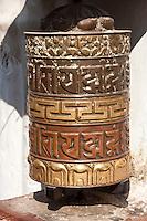 Bodhnath, Nepal.  Buddhist Prayer Wheel Bearing Mantra Om Mani Padme Hum.