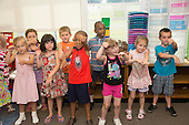 MR / Schenectady, NY. Zoller Elementary School (urban public school). Kindergarten classroom. Students do hand motions and sing songs together. MR: AM-gKw. ID: AM-gKw. © Ellen B. Senisi.