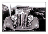 The King Rolls Royce Phantom III with a Ford at the right, in the bunker build by UNESCO in the courtyard of the Afghan Kabul National museum in 1991.