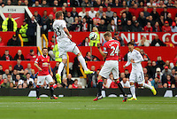 Pictured L-R: Gylfi Sigurdsson of Swansea wins a header against Darren Fletcher of Manchester United. Saturday 16 August 2014<br />