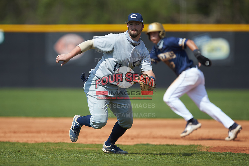 Catawba Indians first baseman Cameron Morrison (11) on defense against the Queens Royals during game two of a double-header at Tuckaseegee Dream Fields on March 26, 2021 in Kannapolis, North Carolina. (Brian Westerholt/Four Seam Images)