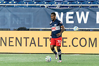 FOXBOROUGH, MA - OCTOBER 3: Cristian Penilla #70 of New England Revolution brings the ball forward during a game between Nashville SC and New England Revolution at Gillette Stadium on October 3, 2020 in Foxborough, Massachusetts.