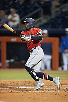 Luis Marte (8) of the Jacksonville Jumbo Shrimp follows through on his swing against the Durham Bulls at Durham Bulls Athletic Park on May 15, 2021 in Durham, North Carolina. (Brian Westerholt/Four Seam Images)