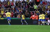 Saturday 28 September 2013<br /> Pictured: Aaron Ramsey of Arsenal (C) celebrating his goal.<br /> Re: Barclay's Premier League, Swansea City FC v Arsenal at the Liberty Stadium, south Wales.