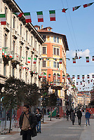 Milano, celebrazione del 150° anniversario dell'Unità d'Italia. Bandiere Tricolore in Via Paolo Sarpi, quartiere Chinatown --- Milan, celebration of the 150th anniversary of the Unification of Italy. Italian flags in Paolo Sarpi street, Chinatown district
