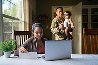 Happy US Army soldier, his wife and daughter, inside home, model-released, stock photo, DoD compliant, for sale, for advertising