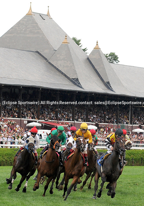 16 August 2008: Horses enter the clubhouse turn with the venerable spires of Saratoga Race Course in Saratoga Springs, New York in the background.