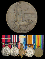 BNPS.co.uk (01202 558833)<br /> Pic: DixNoonanWebb/BNPS<br /> <br /> Pictured: William Tapsell's memorial plaque and medals.<br /> <br /> The heroism of a Tommy who rescued 19 comrades buried in dugout after a shell attack can be revealed after his medals sold for £10,000.<br /> <br /> Second Lieutenant William Tapsell, of the 2nd Battalion, Lincolnshire Regiment, went to their aid after a German gas shell attack on the Western Front in the summer of 1917.<br /> <br /> He started digging out men wearing a gas helmet but because of the darkness was struggling to see so he took it off.<br /> <br /> By doing so he risked his own life as six of the men trapped were killed by lethal fumes.