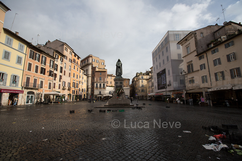 Campo de' Fiori.<br /> <br /> Rome, Italy. 17th Mar, 2021. Documenting Rome from a Bus window (Number 81) and during a quick walk in the City center, while the new and tougher Covid-19 restrictions, imposed by Mario Draghi's Government, have been implemented since Monday morning in Rome, its surrounding Lazio Region, and other 9 Regions, including: Lombardia, Campania, Molise, Emilia Romagna, Friuli-Venezia Giulia, Marche, Piemonte, Puglia, Veneto and Autonomous Province of Trento. The local authorities tightened rules and restrictions due to a spike in the Covid-19 / Coronavirus cases. A new self-certification (autocertificazione, downloadable from here 1.) is needed to leave home which is allowed only for urgent reasons, mainly work and health. Italy will be placed under nationwide lockdown over the Easter weekend. <br /> <br /> Footnotes & Links:<br /> 1. http://www.regione.lazio.it/binary/rl_main/tbl_news/autocertificazione_1_.pdf