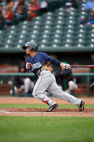 Burlington Bees third baseman Jeyson Sanchez (30) follows through on a swing during a game against the Great Lakes Loons on May 4, 2017 at Dow Diamond in Midland, Michigan.  Great Lakes defeated Burlington 2-1.  (Mike Janes/Four Seam Images)