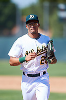 Oakland Athletics outfielder Yhoelnys Gonzalez (23) jogs off the field between innings during an Instructional League game against the Cincinnati Reds on September 29, 2017 at Lew Wolff Training Complex in Mesa, Arizona. (Zachary Lucy/Four Seam Images)
