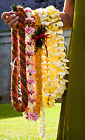 Woman holding Hawaiian floral leis from Lei Day in Hawaii
