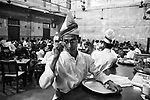 A bearer keeps an eye at the customers at Indian Coffee House at College street in Kolkata, India.