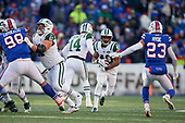 New York Jets running back Trenton Cannon (40) takes the handoff from quarterback Sam Darnold (14) as Spencer Long (61) blocks during an NFL football game against the Buffalo Bills, Sunday, December 9, 2018, in Orchard Park, N.Y.  (Mike Janes Photography)
