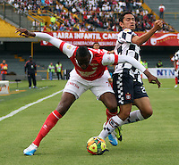 BOGOTA - COLOMBIA -22 -03-2014: Yerry Mina(Izq)  jugador de Independiente Santa Fe disputa el balón con Alejandro Mahecha (Der) jugador de Boyaca Chico FC, durante partido por la fecha 12 de la Liga Postobon I-2014, jugado en el estadio Nemesio Camacho El Campin de la ciudad de Bogota. / Yerry Mina (L) jugador of Independiente Santa Fe vies for the ball with  Alejandro Mahecha (R) player of Boyaca Chico FC during a match for the 12th date of the Liga Postobon I-2014 at the Nemesio Camacho El Campin Stadium in Bogota city, Photo: VizzorImage  / Felipe Caicedo / Staff.