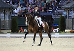 Marcela Krinke-Susmeli and Corinth of Switzerland perform their Freestyle Dressage in the Grand Prix Freestyle Dressage competition at the Alltech World Equestrian Games in Lexington, Kentucky.
