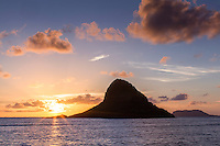 Sunrise behind Mokoli'i (a.k.a. Chinaman's Hat) Island, Kualoa Beach Park, O'ahu.