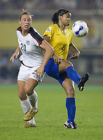 Brazil midfielder (5) Renata Costa and USA forward (20) Abby Wambach. Brazil (BRA) defeated the United States (USA) 4-0 during the FIFA Women's World Cup China 2007 at Hangzhou Dragon Stadium in Hangzhou, China, on September 27, 2007. Brazil advances to the finals, while the United States will play in the third place game on September 30th.