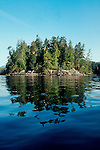 Island, British Columbia, Canada, A small, perfect, forested, rocky-shored island off the west coast of Vancouver Island in Barkley Sound, British Columbia, Canada