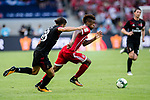 Bayern Munich Forward Kingsley Coman (R) fights for the ball with AC Milan Midfielder Ricardo Rodriguez (L) during the 2017 International Champions Cup China  match between FC Bayern and AC Milan at Universiade Sports Centre Stadium on July 22, 2017 in Shenzhen, China. Photo by Marcio Rodrigo Machado / Power Sport Images
