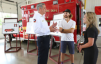 Bentonville fire chief Brent Boydston (from left) speaks with Steuart Walton, Runway Group Co-Founder, and Bentonville mayor Stephanie Orman after the formal announcement Monday, July 26, 2021, of the purchase of a new aircraft rescue firefighting vehicle at Station No. 6 in Bentonville. The event recognized an $800,000 grant to the Fire Department to purchase an aircraft rescue firefighting vehicle for the municipal airport. The City Council recently approved a budget adjustment of $800,000 in revenue via The Runway Fund at Fidelity Charitable grant at the recommendation of Steuart Walton, and allocated $865,000 in expenses to purchase the vehicle. Check out nwaonline.com/210727Daily/ and nwadg.com/photos for a photo gallery.(NWA Democrat-Gazette/David Gottschalk)