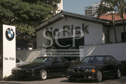 """Sao Paulo, Brazil. """"No Risk"""" armoured motor car and security service with two armoured BMW cars; Jardins district."""