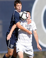 Jimmy Nealis #16 of Georgetwn University is mugged by Sean Margenthal #12 of Villanova University during a Big East match at North Kehoe Field, Georgetown University on October16 2010 in Washington D.C. Georgetown won 3-1.