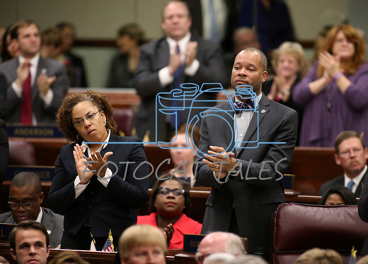 Assemblywoman Dina Neal, D-North Las Vegas, and Sen. Aaron Ford, D-Las Vegas, react to a point made by Gov. Brian Sandoval during his State of the State address at the Legislative Building in Carson City, Nev., on Thursday night, Jan. 15, 2015. (Las Vegas Review-Journal/Cathleen Allison)