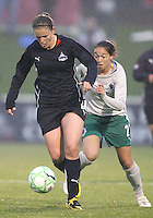 Cat Whitehill #4 of the Washington Freedom gets away from Kerri Hanks #2 of St. Louis Athletica during a WPS match at the Maryland Soccerplex on May 3, 2009 in Boyds Maryland. The game ended in a 3-3 tie.