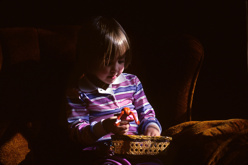 Girl paying with dolls.
