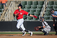 Corey Zangari (14) of the Kannapolis Intimidators follows through on his swing against the Greenville Drive at Intimidators Stadium on June 7, 2016 in Kannapolis, North Carolina.  The Drive defeated the Intimidators 4-1 in game one of a double header.  (Brian Westerholt/Four Seam Images)