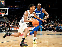 WASHINGTON, DC - FEBRUARY 05: Terrell Allen #12 of Georgetown dribbles away from Quincy McKnight #0 of Seton Hall during a game between Seton Hall and Georgetown at Capital One Arena on February 05, 2020 in Washington, DC.